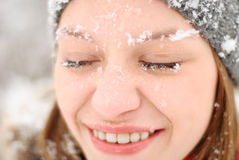 Girl's face with snow outdoors Royalty Free Stock Photography