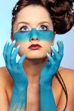 Girl's fantasy blue body-art Stock Photography