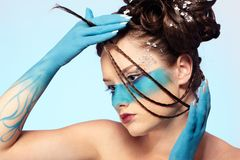 Girl's fantasy blue body-art Stock Photos