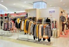 Girl's fashion clothing store stock photos