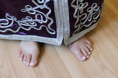 Girl's feet in Moroccan suit Royalty Free Stock Image