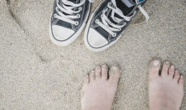 Girl's feet and sneakers Royalty Free Stock Photography