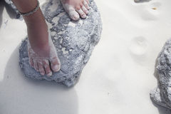 Girl's Feet Standing On Beach Rock Royalty Free Stock Photos