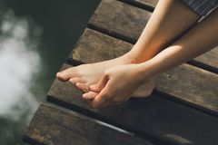 Girl`s feet There was sore from the accident left leg, walking, hiking, walking over the danger of the health disaster aid royalty free stock photo