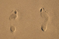 Girl's footprints on send Royalty Free Stock Photography