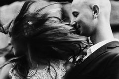Girl's hair touches man's face while she mixes it around.  Royalty Free Stock Photos