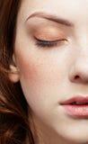 Girl's half-face portrait. Half-face portrait of pale freckled girl royalty free stock images