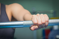 Girl's hand on the barbell Royalty Free Stock Image