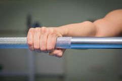 Girl's hand on the barbell Royalty Free Stock Photography