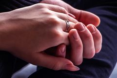 Girl`s hand in the hand of a guy close-up royalty free stock photos