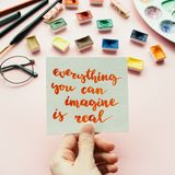 Girl`s hand holding card with inspirational quote royalty free stock photos