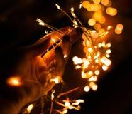 Girl`s hand holding LED flashlights royalty free stock photography