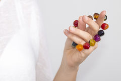 Girl's hand with multicolor bracelet Stock Images