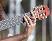 Girl`s hand playing guitar Stock Photo