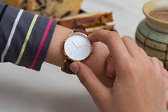 Girl`s hand with wrist watches at the coffee break Stock Photography