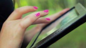 Girl's hands close-up on the tablet dizheniya stock video