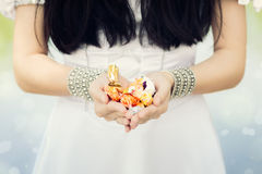 Girl's Hands Holding Candy Stock Images