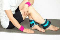 Girl's hands and legs with ankle weights, isolated Stock Photos
