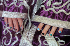 Girl's hands in Moroccan suit Stock Photography