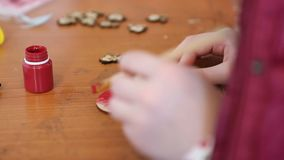 Girl's hands painting wooden heart at craft and maker class, handmade, hobby. Stock footage stock video