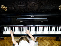 Girl's hands and piano keyboard close-up view Royalty Free Stock Photo