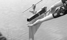 Girl`s hands are playing percussion outdoors.  Black and white. Stock Photography