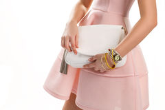 Girl's hands with white purse. Stock Photo