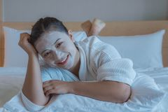 Girl`s happy time of Face Mask pad , beauty skill massage spa of yourself royalty free stock photography