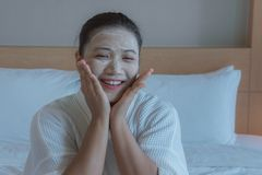 Girl`s happy time of Face Mask pad , beauty skill massage spa of yourself royalty free stock images