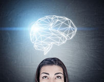 Girl`s head and brain hologram Royalty Free Stock Image