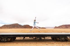 The girl in the Jordanian desert on the railroad stock photography