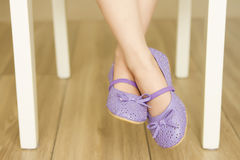 Girl's legs. Cute little girl's legs in violet shoes royalty free stock photography