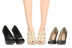 Girl`s legs. Beautiful symmetry legs of the girl isolated on white background royalty free stock photos