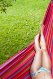 Girl's legs in a hammock Royalty Free Stock Images