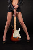 Girl's legs and  hands with electric guitar Stock Photography