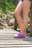 Girl's Legs on the Mountain Bridge Royalty Free Stock Images