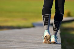 Girl`s legs in running shoes Royalty Free Stock Image