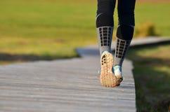Girl`s legs running Stock Photo