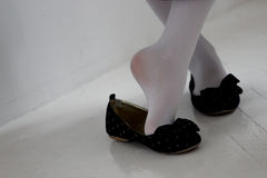The girl's legs in shoes. Royalty Free Stock Photos