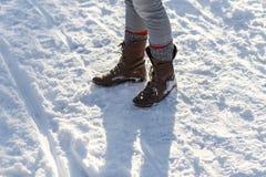 Girl's Legs in the Snow Stock Photo