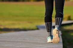 Girl`s legs starting to run Royalty Free Stock Photography