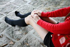Girl's legs wearing long socks Stock Photos