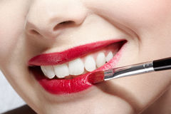 Girl's lips zone makeup Stock Image