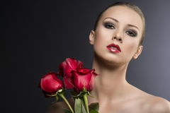 Girl's low key  portrait with roses Royalty Free Stock Images