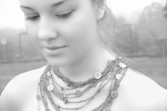 The Girl's Necklace. Beautiful Girl in fog wearing a green necklace, black and white (greyscale Royalty Free Stock Photography
