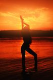 Girl`s outline on sunset background. Red light Royalty Free Stock Image