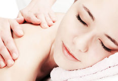 Girl's part of face during massage procedure. Royalty Free Stock Image
