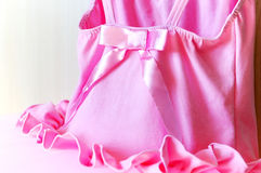 Girl's pink dress of delicate pink fabric Stock Photos