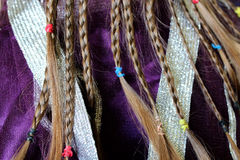 Girl's plaits on the fabric pattern Royalty Free Stock Image