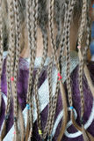 Girl's plaits on the fabric pattern of suit Royalty Free Stock Photography